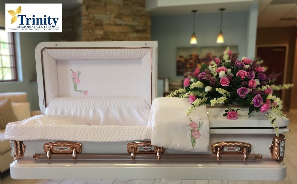 Le respect dû aux morts se perd au Québec et ailleurs dans le monde... Rose_casket-1024x636